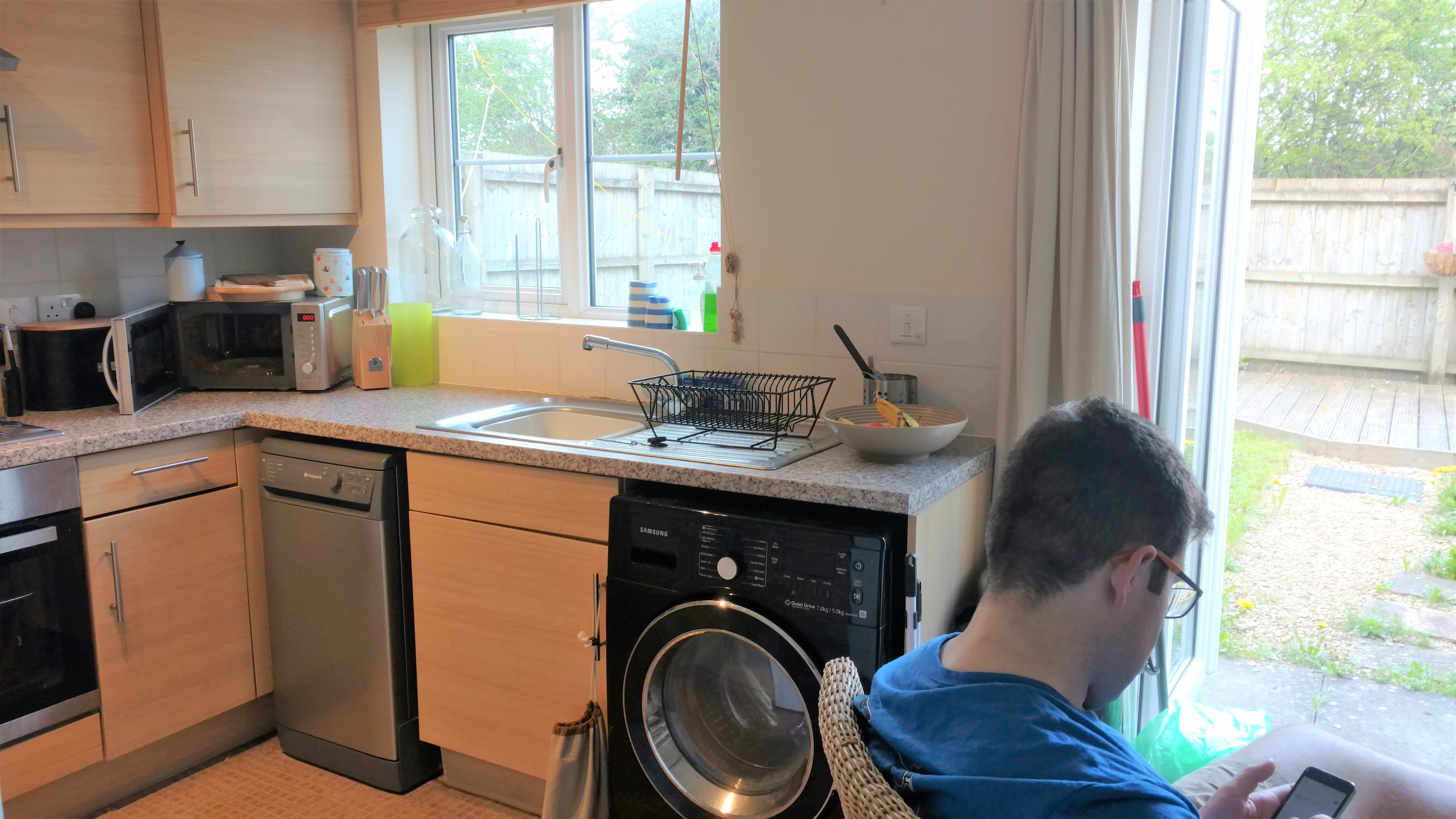 Before photo back window wall kitchen