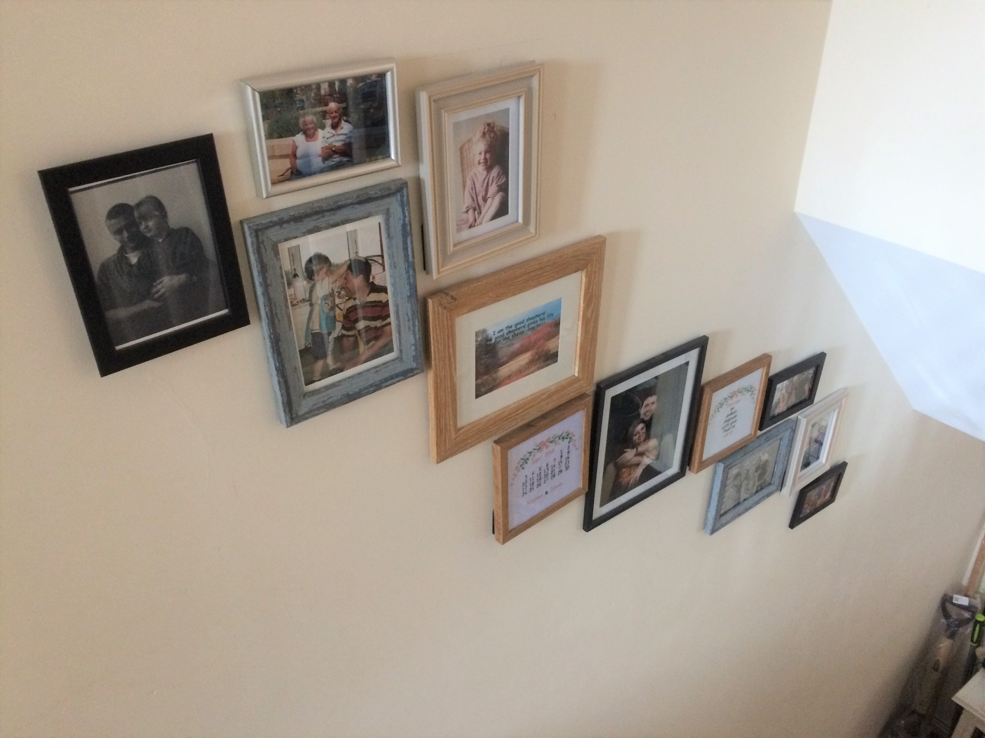 After photo wall above stairs